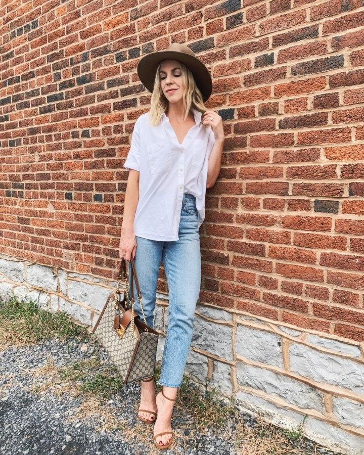 Meagan-Brandon-fashion-blogger-of-Meagans-Moda-wears-oversized-white-button-down-shirt-with-high-waist-mom-jeans-Gucci-bag-and-suede-stiletto-sandals